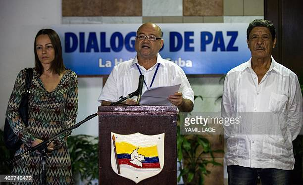 Commander of the FARCEP leftist guerrillas Carlos Antonio Lozada reads a statement flanked by Isaias Trujillo and Dutch Tanja Nijmeijer at the...