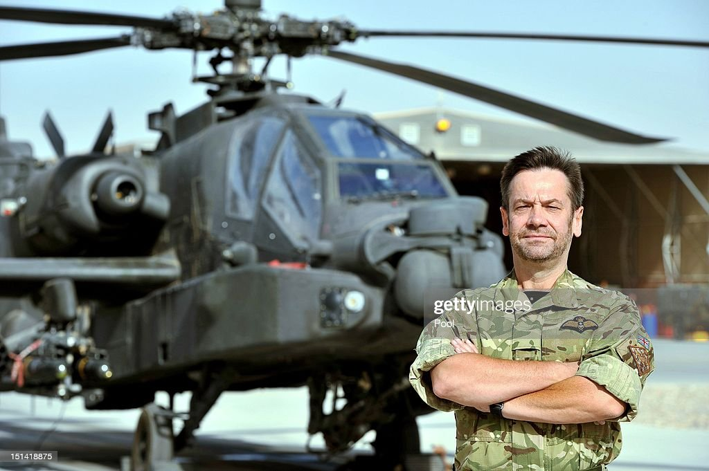 Commander of the Joint Aviation Group, Captain Jock Gordon (Royal Navy) poses in front of the Apache flight-line at Camp Bastion in Afghanistan at Camp Bastion on September 7, 2012 in Helmand Province, Afghanistan. Captain Jack Gordon will be Prince Harry's Commanding Officer as he is redeployed to the region to pilot attack helicopters.