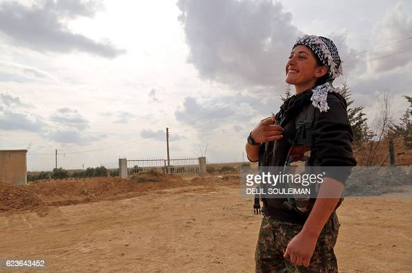 A commander of the Kurdish female Women's Protection Units reacts in the village of Tuwaylaa just outside the city of Raqa on November 16 2016 The...