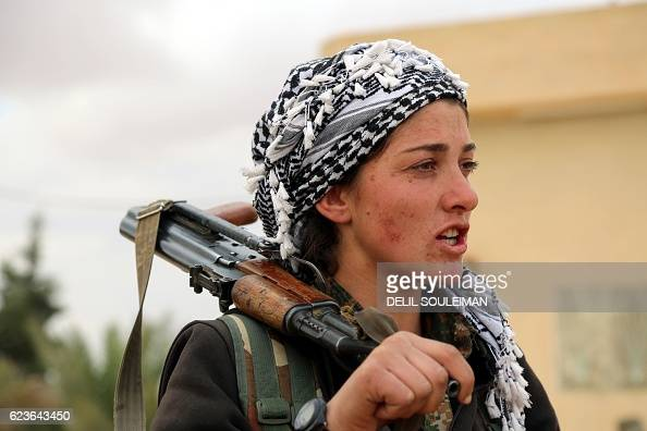 TOPSHOT A commander of the Kurdish female Women's Protection Units speaks in the village of Tuwaylaa just outside the city of Raqa on November 16...