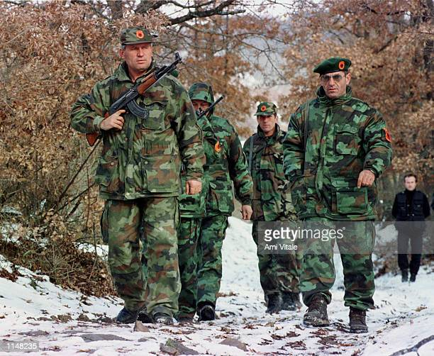 Commander of the Obrinje region of the Kosovo Liberation Army Gani Koci right trains with his troops Monday December 14 1998 Monday night over 30...