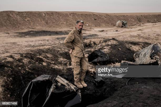 Commander of the Shia brigade Liwa alMuntadhir stands on a cut oil pipeline near the frontline against the Islamic State in the Nineveh plains of...