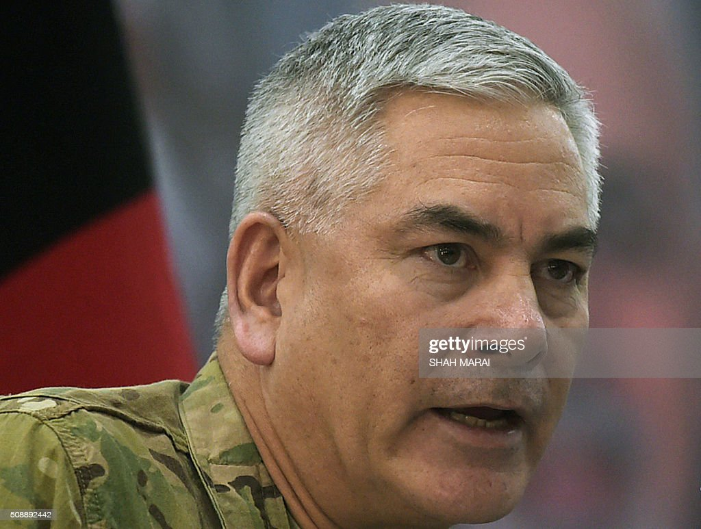 Commander of US and NATO forces in Afghanistan General John F. Campbell speaks during a joint press conference with Afghan Acting Defence Minister Masoom Stanekzai (unseen) in Kabul on February 7, 2016. AFP PHOTO / SHAH Marai / AFP / SHAH MARAI
