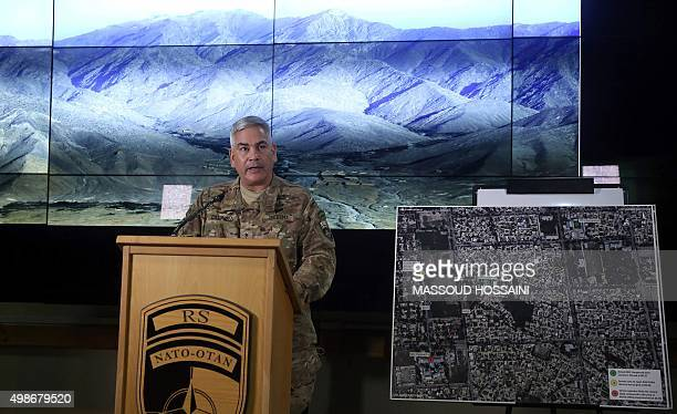 Commander of US and NATO forces in Afghanistan General John F Campbell stands beside a map of the northern Afghan city of Kunduz as he addresses a...