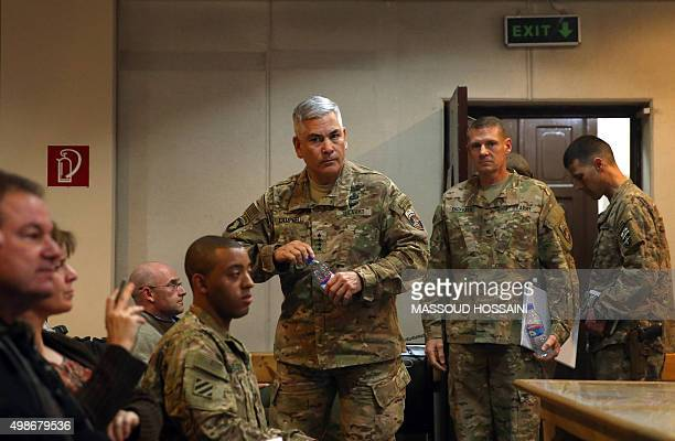 Commander of US and NATO forces in Afghanistan General John F Campbell arrives to address a press conference at Resolute Support headquarters in...