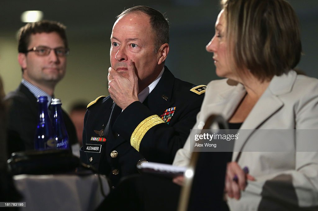 Commander of U.S. Cyber Command and director of the National Security Agency (NSA) General Keith Alexander waits to be introduced during the fourth annual Cybersecurity Summit September 25, 2013 at the National Press Club in Washington, DC. General Alexander discussed 'media leak' and defended for the NSA surveillance program on American people.