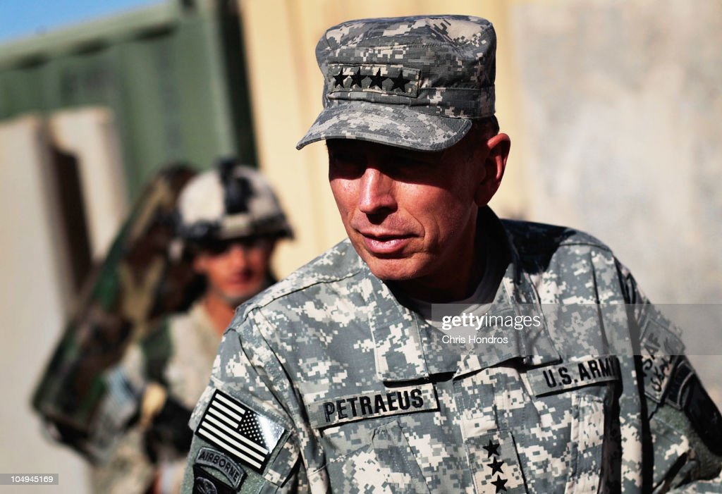 Commander of U.S. forces in Afghanistan General <a gi-track='captionPersonalityLinkClicked' href=/galleries/search?phrase=David+Petraeus&family=editorial&specificpeople=175826 ng-click='$event.stopPropagation()'>David Petraeus</a> walks on Forward Base Wilson October 7, 2010 west of Kandahar, Kandahar Province, Afghanistan. Petraeus visited the field base, located in one of Afghanistan's most dangerous areas, to award Purple Hearts and other commendations and to give a talk to troops in the 101st Airborne Division that are stationed in the volatile region.
