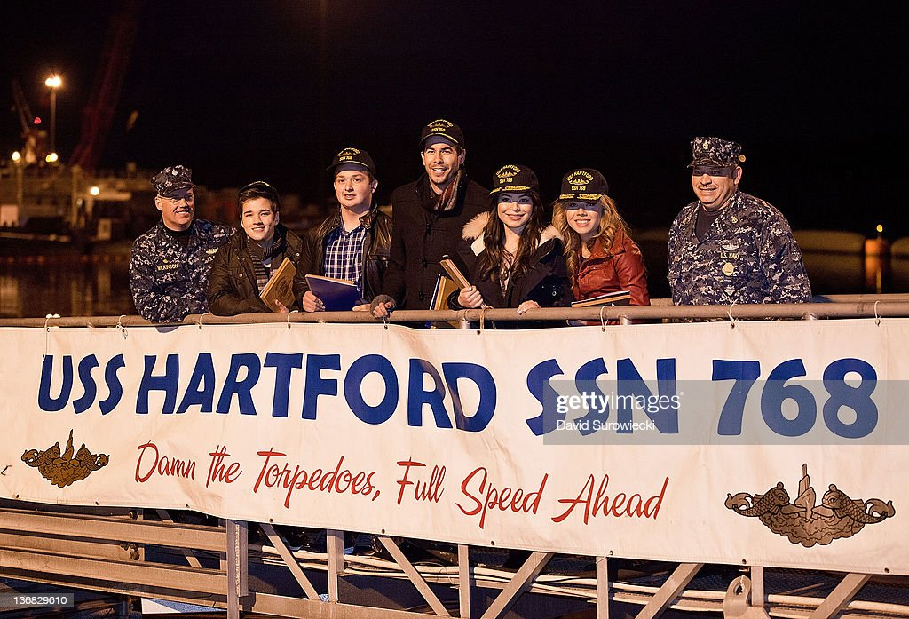 Commander Steve Wilkinson (L) poses with the cast of iCarly, (L-R) Nathan Kress, Noah Munck, Jerry Trainor, Miranda Cosgrove, Jennette McCurdy, and a Naval officer onboard the submarine USS Hartford at Naval Submarine Base New London on January 11, 2012 in Groton, Connecticut. The cast of Nickelodeon's iCarly were presenting a special military family screening of iMeet The First Lady, an episode of their show featuring Michelle Obama.