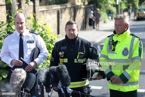 Commander Stuart Cundy of Met Police Steve Apter of London Fire Brigade and Paul Woodrow director of ops london ambulance service hold a press...