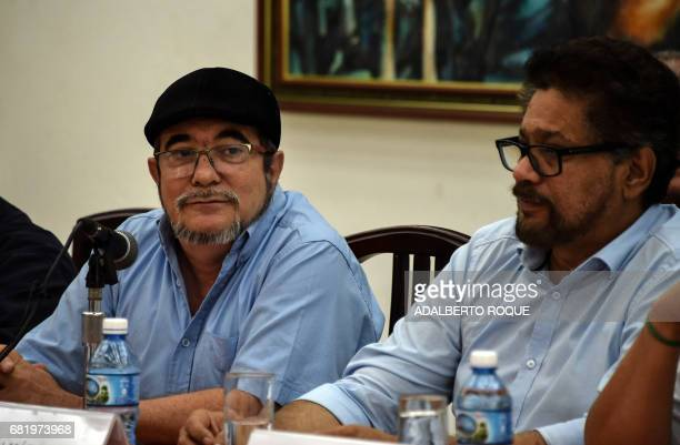 Commanders of FARCEP leftist guerrilla Timoleon Jimenez and Ivan Marquez participate in a joint press conference with Colombian National Liberation...