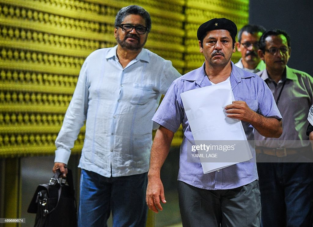 Commanders of FARC-EP leftist guerrillas Ivan Marquez (L) and Edilson Romana (R) arrive at Convention Palace in Havana to attend peace talks with the Colombian government, on April 14, 2015. Colombian President Juan Manuel Santos announced last week he was extending the suspension of air raids on the leftist FARC guerrillas to accelerate peace talks aimed at ending the five-decade war. AFP PHOTO/YAMIL LAGE