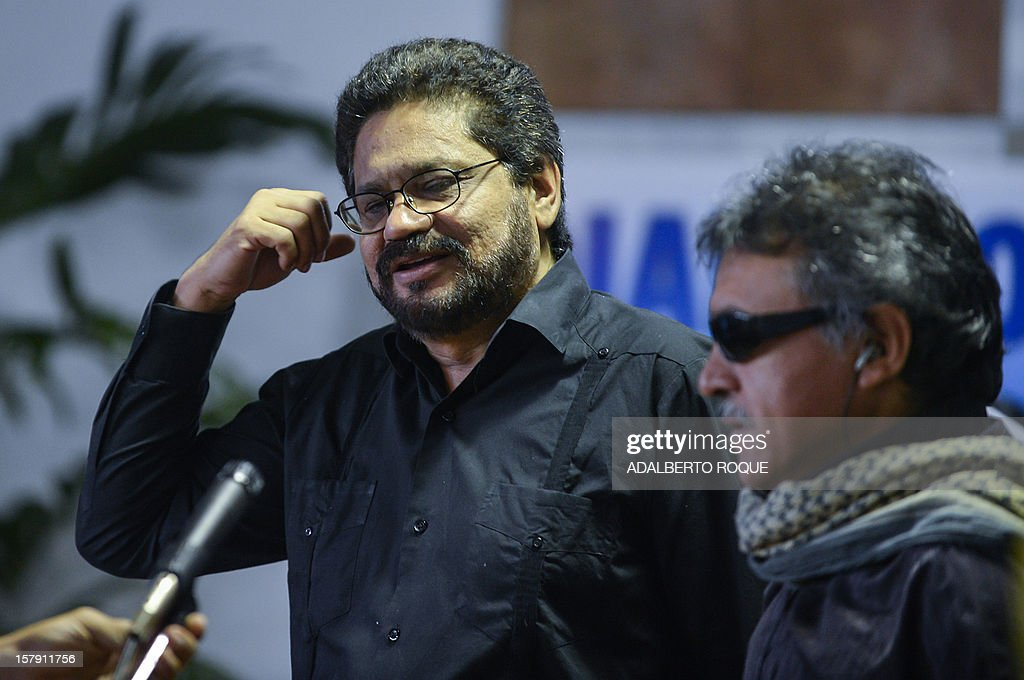 Commanders of FARC-EP leftist guerrillas Jesus Santrich (R) and Ivan Marquez (L) speak as they arrive at the Convention Palace in Havana for the peace talks with the Colombian government, on December 7, 2012.