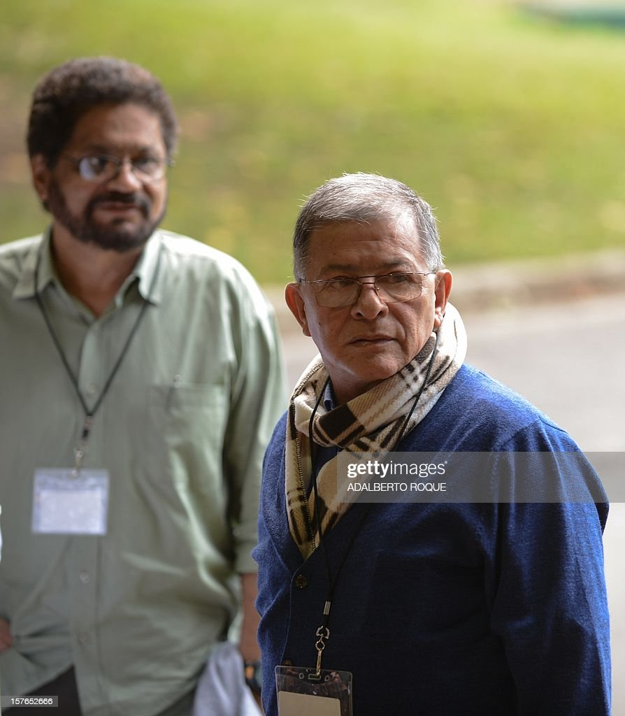 Commanders of FARC-EP leftist guerrillas Rodrigo Granda (R) and Ivan Marquez (L) arrive at the Convention Palace in Havana for the peace talks with the Colombian government, on December 5, 2012. AFP PHOTO/ADALBERTO ROQUE