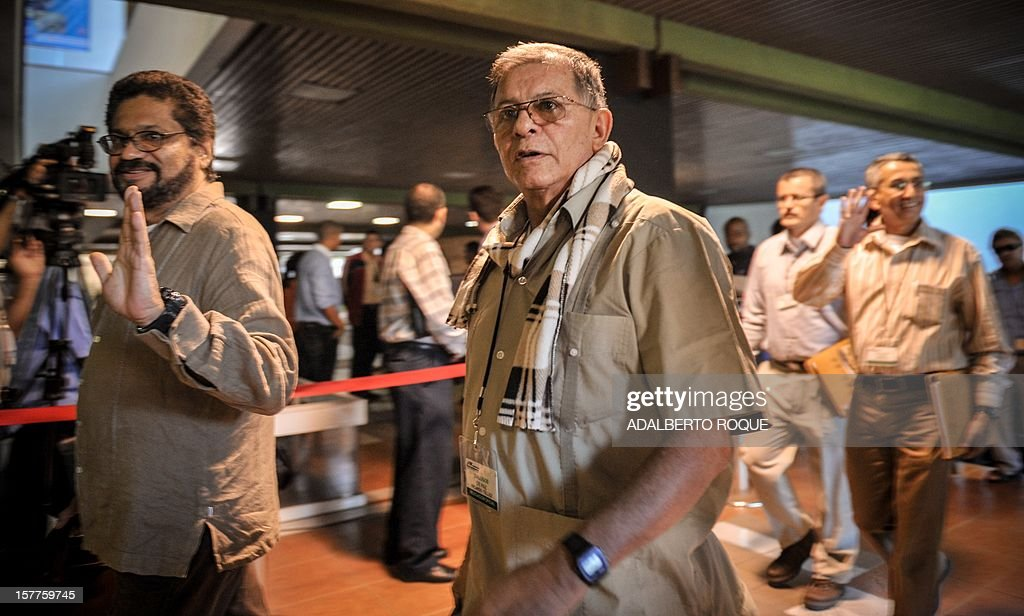 Commanders of FARC-EP leftist guerrillas Rodrigo Granda (R) and Ivan Marquez (L) arrive at the Convention Palace in Havana for the peace talks with the Colombian government, on December 6, 2012.