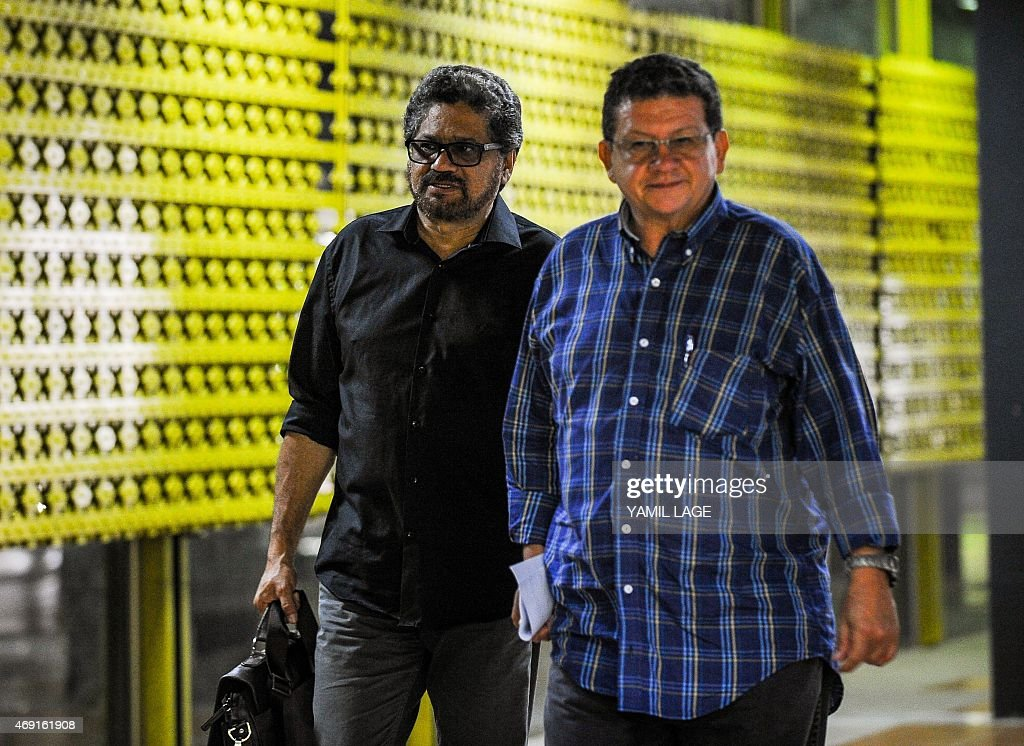Commanders of the Colombian FARC-EP leftist guerrillas Ivan Marquez (L) and Pablo Catatumbo arrive at the Convention Palace in Havana for the peace talks with the Colombian government, on April 10, 2015. Colombian President Juan Manuel Santos said Thursday he was extending the suspension of air raids on the leftist FARC guerrillas to accelerate peace talks aimed at ending the five-decade war. Santos first announced a month-long suspension of bombing raids on the Revolutionary Armed Forces of Colombia (FARC) on March 10, saying he wanted to 'de-escalate' the conflict. AFP PHOTO/YAMIL LAGE