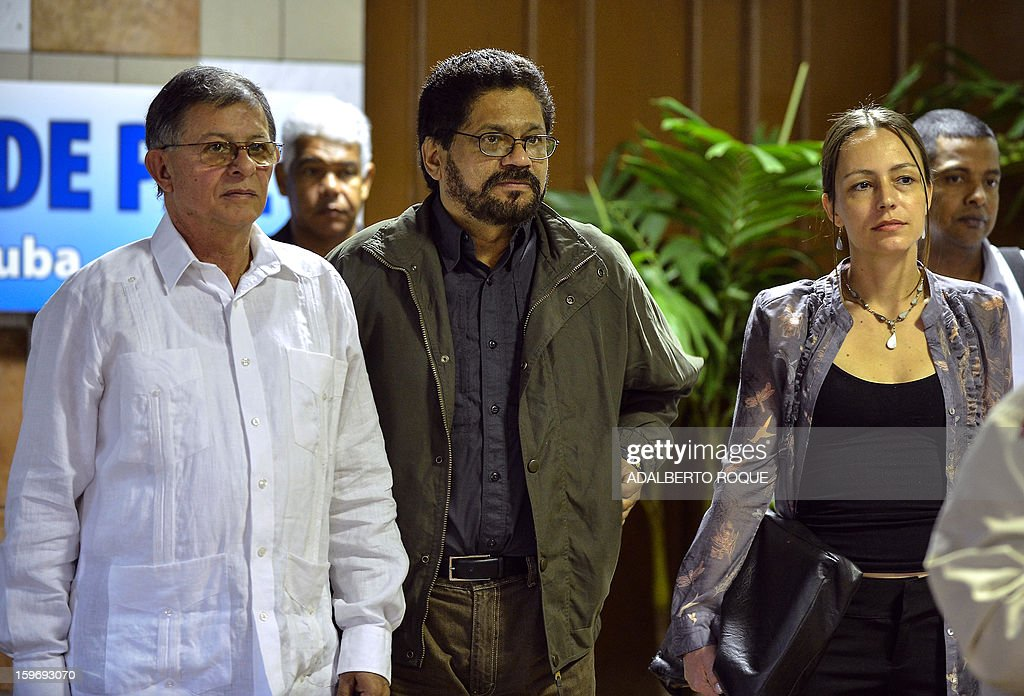 Commanders of the FARC-EP Colombian leftist guerrilla Ivan Marquez (C), Rodrigo Granda (L) and Dutch guerrilla fighter Tanja Nijmeijer (R) arrive at Convention Palace in Havana to take part in the peace talks with the Colombian government, on January 18, 2013.