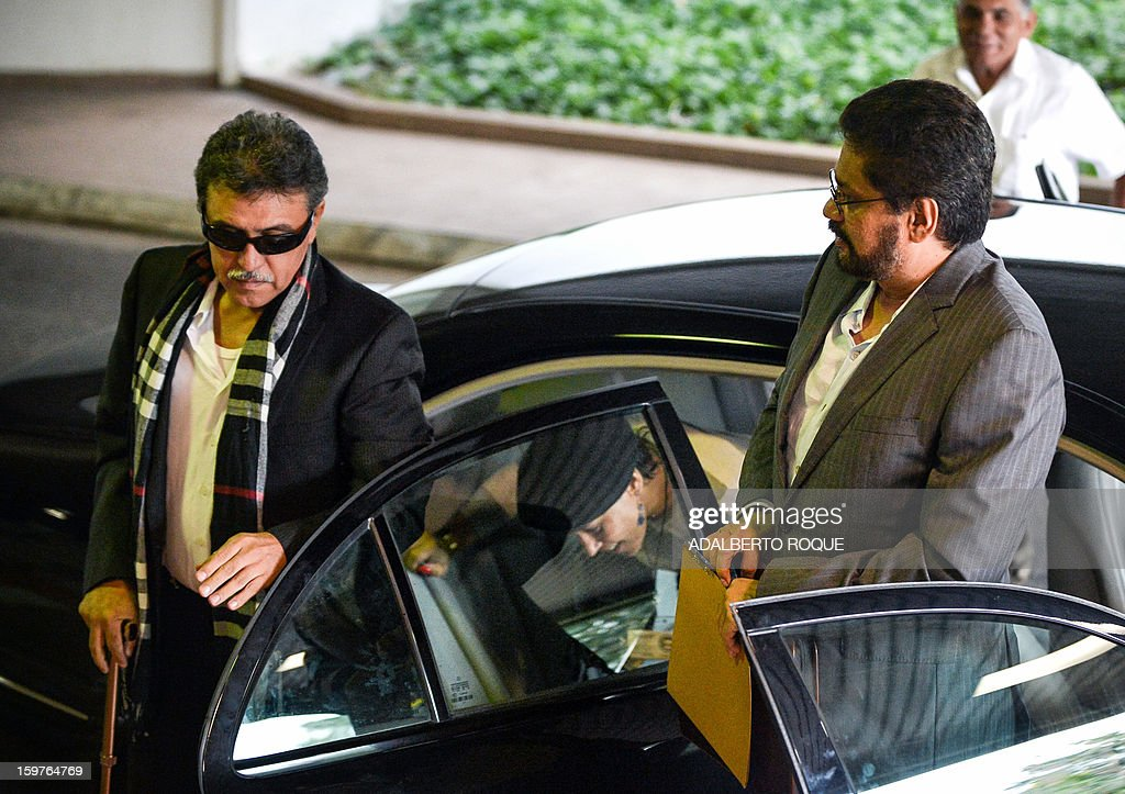 Commanders of the FARC-EP leftist guerrillas Ivan Marquez (R) and Jesus Santrich (L) arrive at the Convention Palace in Havana for peace talks with the Colombian government, on January 20, 2013. Marquez announced the end of a two-month unilateral ceasefire. Colombian President Juan Manuel Santos has warned the country's leftist rebels against resuming violent guerrilla operations, saying the army and police were ready to respond to their attacks. AFP PHOTO/ADALBERTO ROQUE