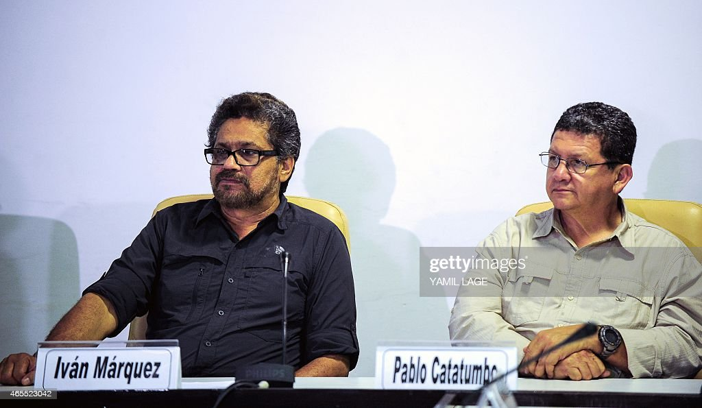Commanders of the FARC-EP leftist guerrillas Ivan Marquez (L) and Pablo Catatumbo (R) attend a press conference related to peace talks with the Colombian government at the Convention Palace in Havana, on March 7, 2014. AFP PHOTO/Yamil LAGE