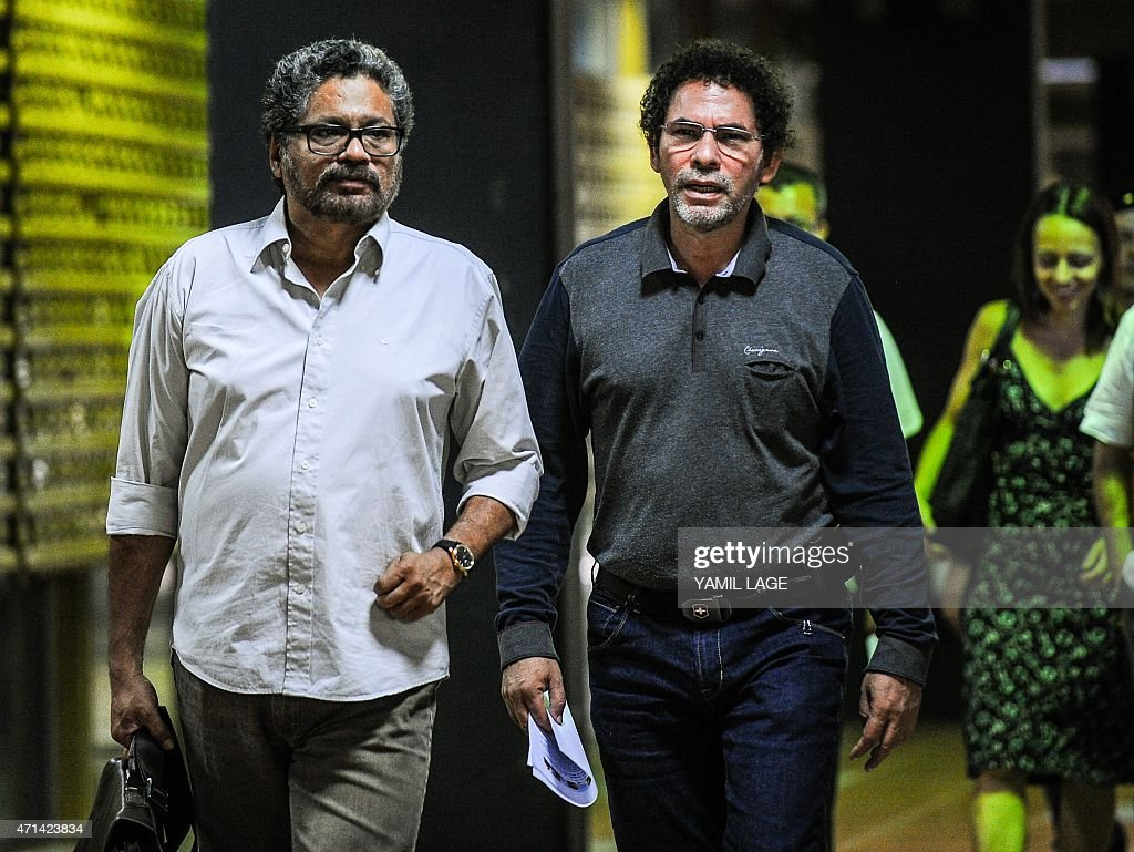 Commanders of the FARC-EP leftist guerrillas Ivan Marquez (L) and Pastor Alape (R) arrive at Convention Palace in Havana for the peace talks with the Colombian government, on April 28, 2015. AFP PHOTO/YAMIL LAGE