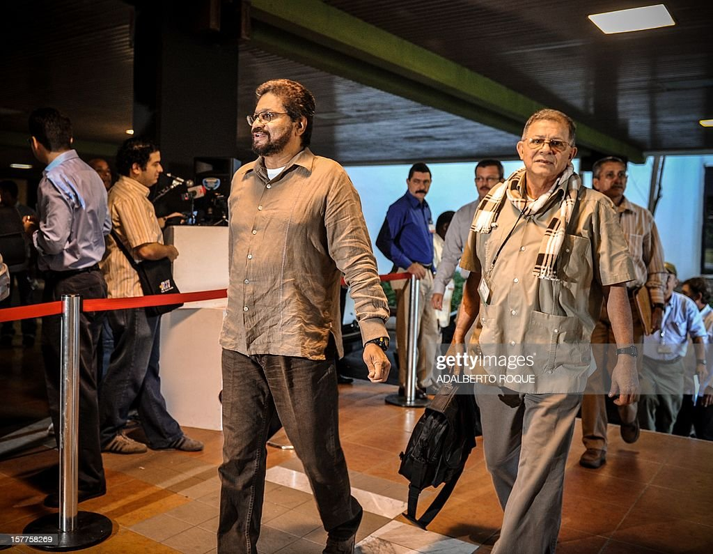 Commanders of the FARC-EP leftist guerrillas Rodrigo Granda (R) and Ivan Marquez (L) arrive at the Convention Palace in Havana for the peace talks with the Colombian government, on December 6, 2012.AFP PHOTO/ADALBERTO ROQUE