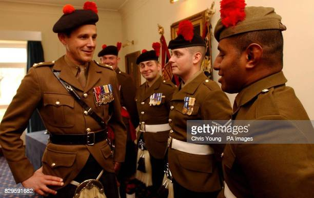Commanding Officer of the Black Watch during their recent deployment in Iraq Lt Col James Cowan congratulates Company Sergeant Major David 'Harry'...
