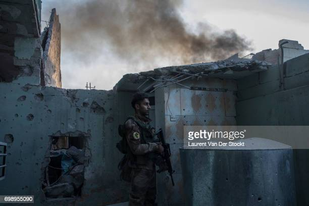 A commando of 7 men of the 1st brigade of the ISOF fights Daesh house by house to take control of Al Saha one of the last districts of Mosul be still...