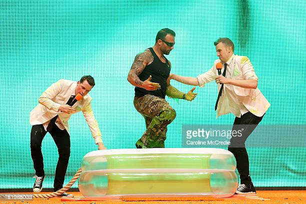 'Commando' Steve Willis gets slimed during the Nickelodeon Slimefest 2013 evening show at Sydney Olympic Park Sports Centre on September 27 2013 in...