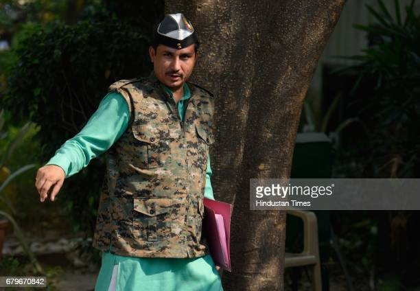 MLA commando Surender Singh arrives to attend the Aam Aadmi Party MLAs meeting at Delhi CM Arvind Kejriwal House on May 6 2017 in New Delhi India...