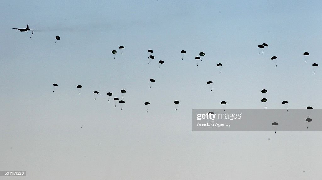 Commandos jump out of an airplane with their parachutes during Erciyes-2016 Airborne Exercise of Battalion Task Force held by 1st. Commando Brigade Command in Kayseri, Turkey on May 25, 2016.