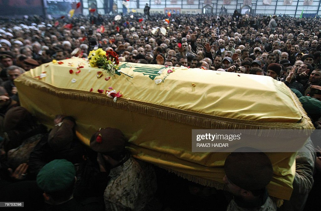 Commandos of the Shiite Muslim Hezbollah movement carry the coffin of assassinated Hezbollah commander Imad Mughnieh in Beirut's southern suburbs on...