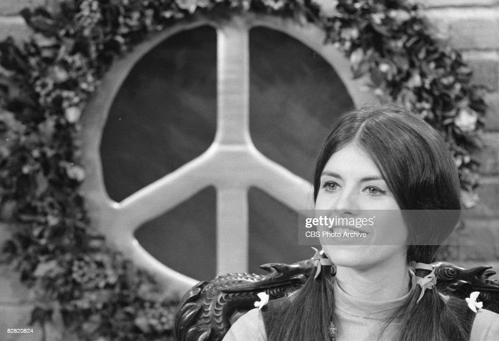 Commedienne and actress Leigh French (as Goldie O'Keefe) appears in a sketch on an episode of the television comedy and variety show, 'The Smothers Brothers Comedy Hour,' Los Angeles, California, December 13, 1968. A large peace symbol in a wreath of leaves is visible behind her.