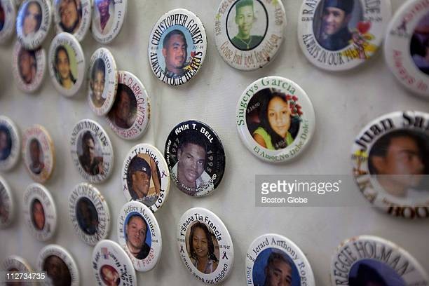 Commemorative buttons for victims are on a wall before City Councilor Ayanna Pressley chairs a hearing devoted to hearing directly from the families...