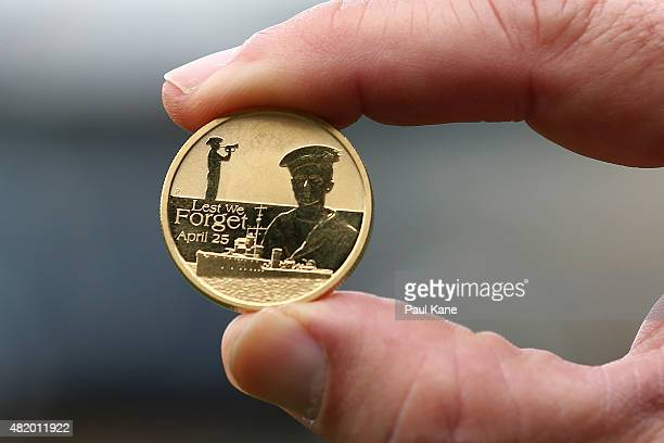 A commemorative coin is seen ahead of the coin toss during the round 17 AFL match between the West Coast Eagles and the Sydney Swans at Domain...