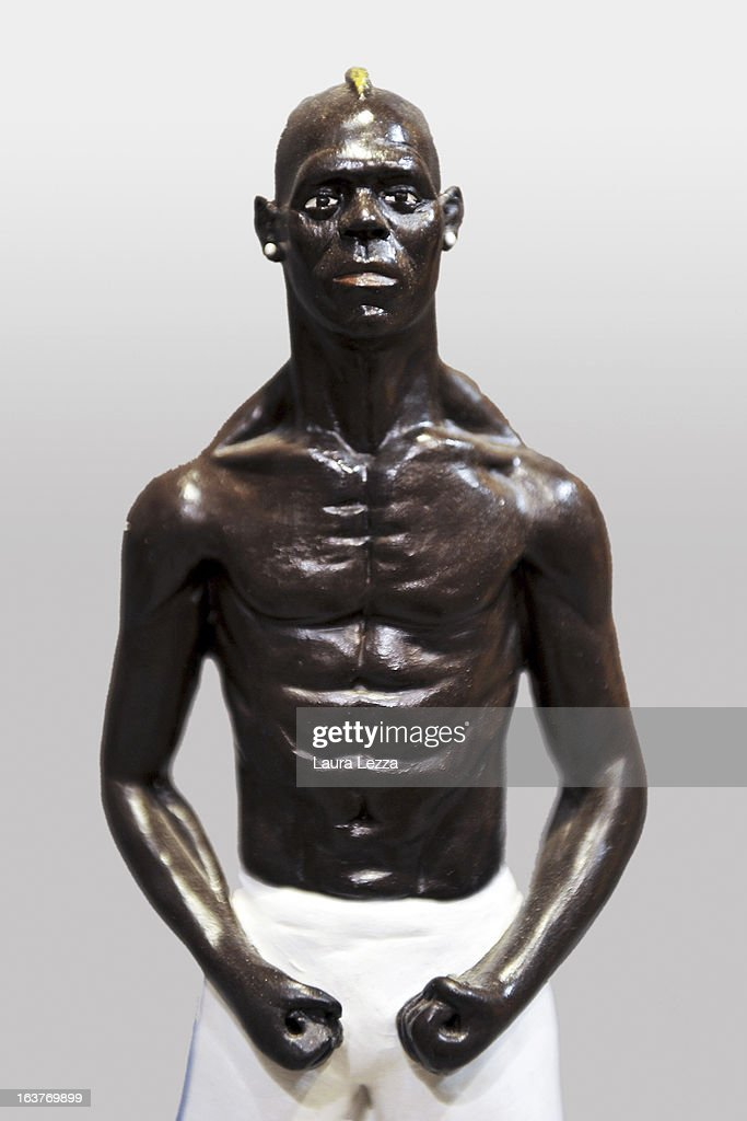 A commemorative figurine created by artisan Genny Di Virgilio depicting football player <a gi-track='captionPersonalityLinkClicked' href=/galleries/search?phrase=Mario+Balotelli&family=editorial&specificpeople=4940446 ng-click='$event.stopPropagation()'>Mario Balotelli</a> is displayed at San Gregorio Armeno on March 14, 2013 in Naples, Italy.