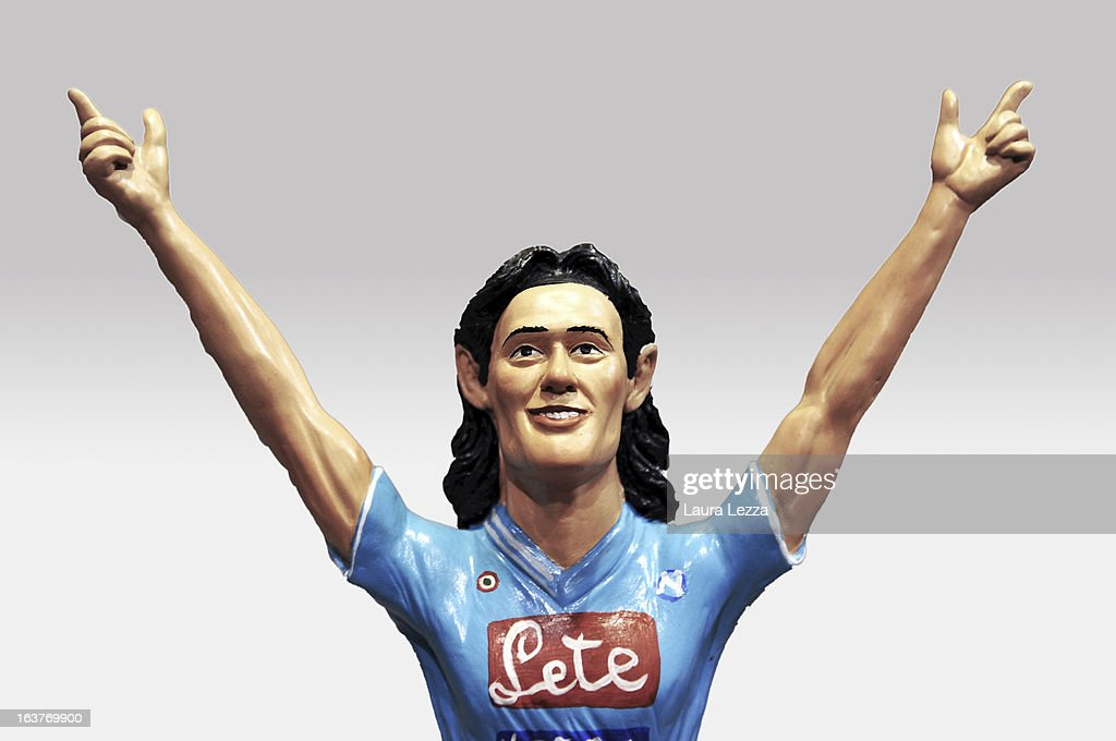 A commemorative figurine created by artisan Genny Di Virgilio depicting Napoli FC football player Edinson Cavani is displayed at San Gregorio Armeno on March 14, 2013 in Naples, Italy.