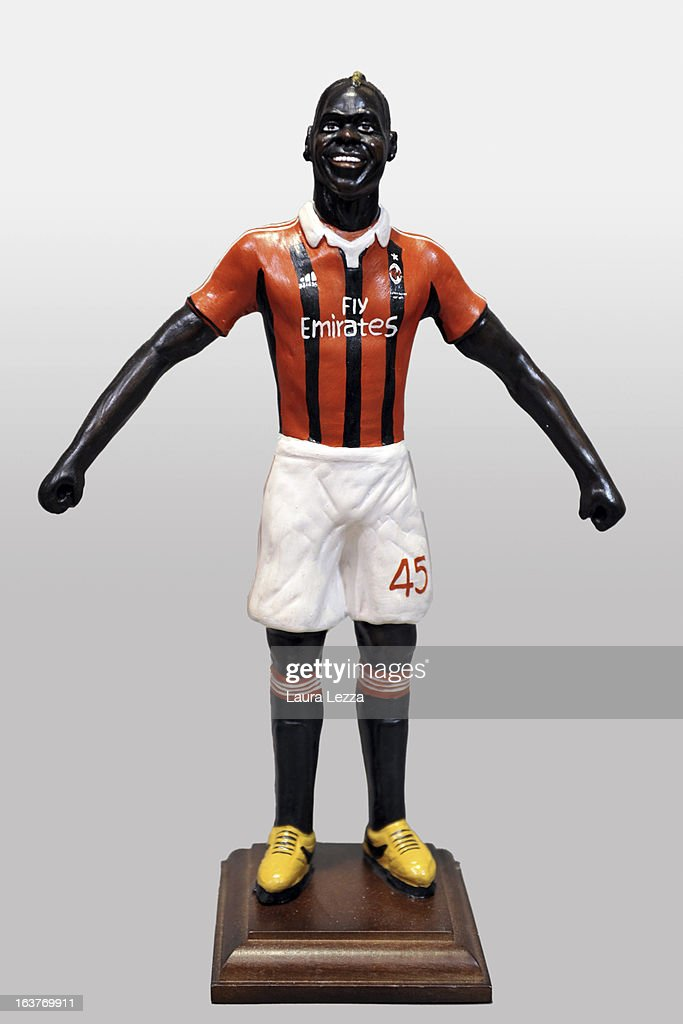 A commemorative figurine created by artisan Genny Di Virgilio depicting AC Milan football player <a gi-track='captionPersonalityLinkClicked' href=/galleries/search?phrase=Mario+Balotelli&family=editorial&specificpeople=4940446 ng-click='$event.stopPropagation()'>Mario Balotelli</a> is displayed at San Gregorio Armeno on March 14, 2013 in Naples, Italy.