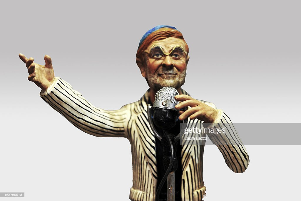 A commemorative figurine created by artisan Genny Di Virgilio depicting Italian singer Lucio Dalla is displayed at San Gregorio Armeno on March 14, 2013 in Naples, Italy.