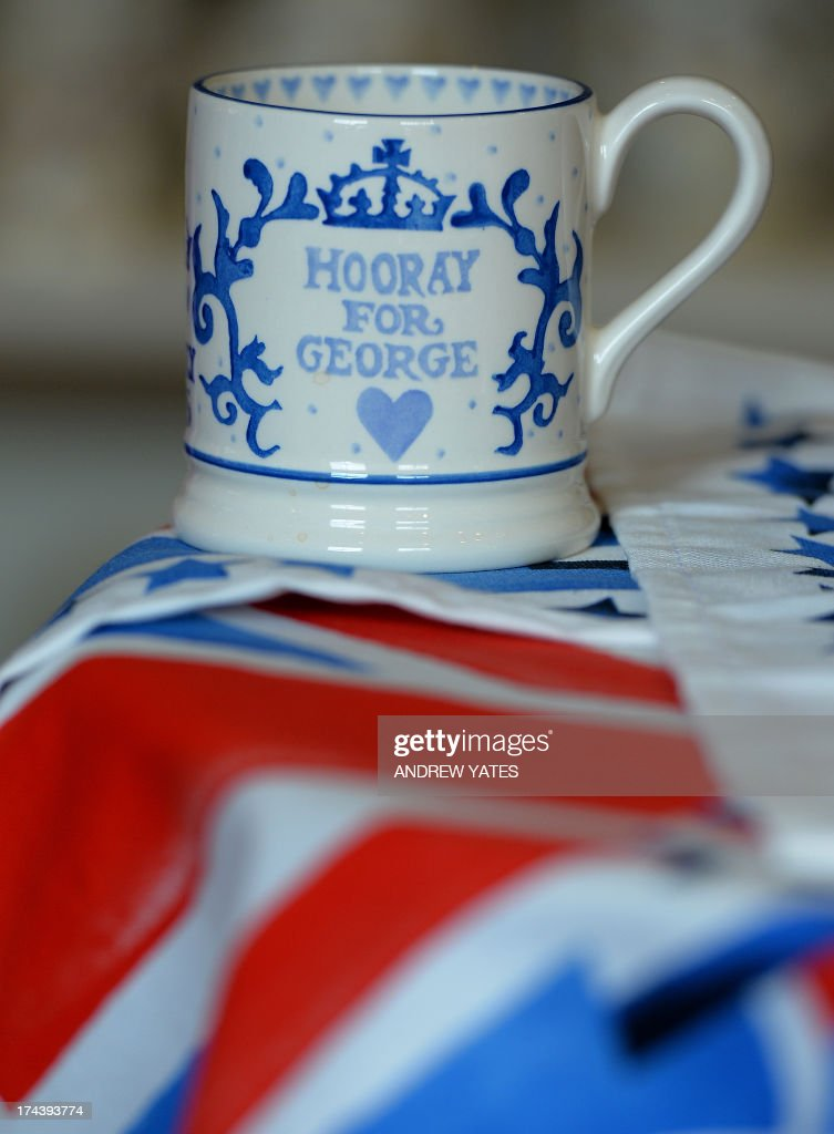 A commemorative mugmade to mark the birth of George Alexander Louis of Cambridge to Prince William and Catherine, The Duchess of Cambridge, is displayed at the Emma Bridgewater pottery in Hanley, Stoke-on-Trent on July 25, 2013 . Ever since Kate's pregnancy was announced in December, retailers have been busily producing all sorts of baby-related items, from tea towels to royal baby potties. But for many royal collectors, it is all about the hand-finished mugs and plates which they can give pride of place on a mantlepiece or a wall. AFP PHOTO/ANDREW YATES