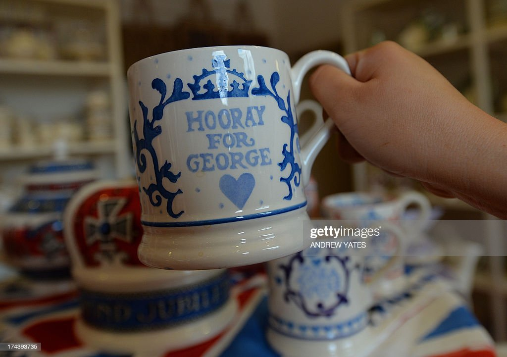 Commemorative mugs made to mark the birth of George Alexander Louis of Cambridge to Prince William and Catherine, The Duchess of Cambridge, are displayed at the Emma Bridgewater pottery in Hanley, Stoke-on-Trent on July 25, 2013 . Ever since Kate's pregnancy was announced in December, retailers have been busily producing all sorts of baby-related items, from tea towels to royal baby potties. But for many royal collectors, it is all about the hand-finished mugs and plates which they can give pride of place on a mantlepiece or a wall. AFP PHOTO/ANDREW YATES
