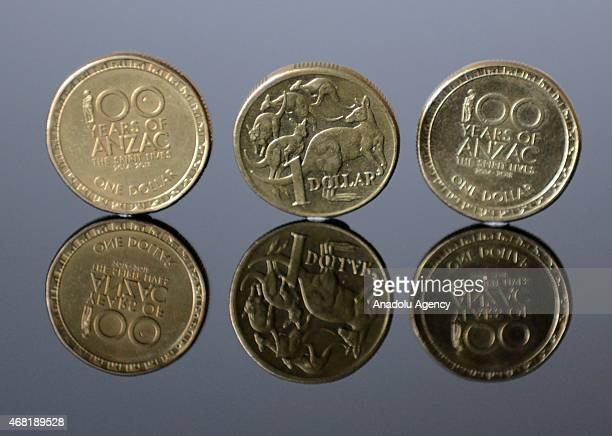 Commemorative one Australian dollar coins reading '100 years of Anzac The Spirit Lives' are seen in Melbourne Australia on March 31 2015 Australia...