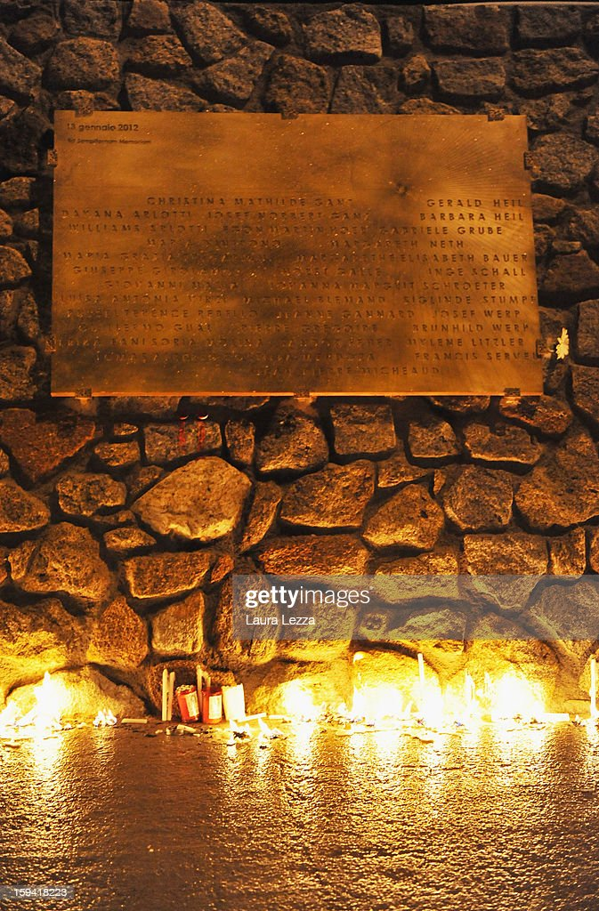 A commemorative plaque in honor of the victims of the sunken Costa Concordia is illuminated by candlelight on the wharf after a minute of silence was held to mark the exact time the ship crashed, on January 13, 2013 in Giglio Porto, Italy. A year after the sinking of the ship Costa Concordia, relatives of the victims, survivors, island residents, law enforcement and institutions gathered to mark the first anniversary and commemorate the dead. More than four thousand people were on board when the ship hit a rock off the Tuscan coast, killing 32 and leaving two people missing.