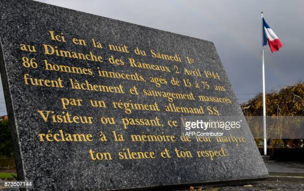 A commemorative plaque is pictured on November 13 2017 in Villeneuved'Ascq northern France reminding of the April 2 1944 WWII massacre of 86...