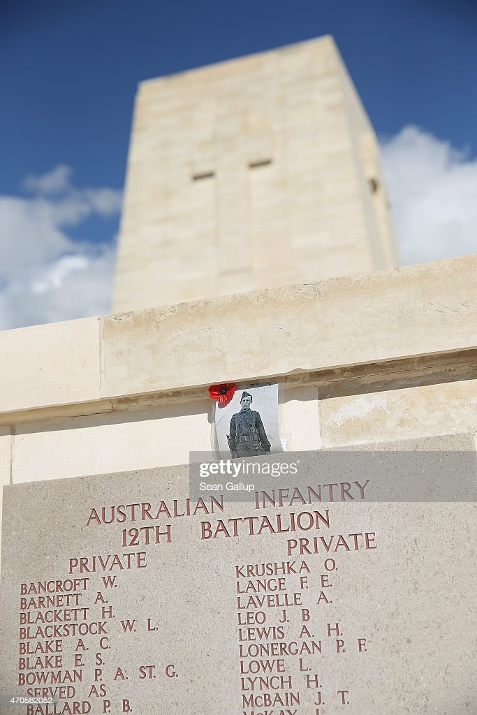 A commemorative poppy and a photograph likely left by a visitor hang next names of Australian soldiers killed during the Gallipoli Campaign at the...
