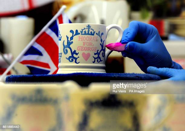 Commemorative Royal Baby mugs go into production at the Emma Bridgewater Factory in Stoke On Trent to celebrate the birth of Prince George of...