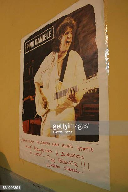 A commemorative sign with the verses of the song 'Appocundria' Two years after the death of Pino Daniele fans gathered in Piazza Santa Maria la Nova...