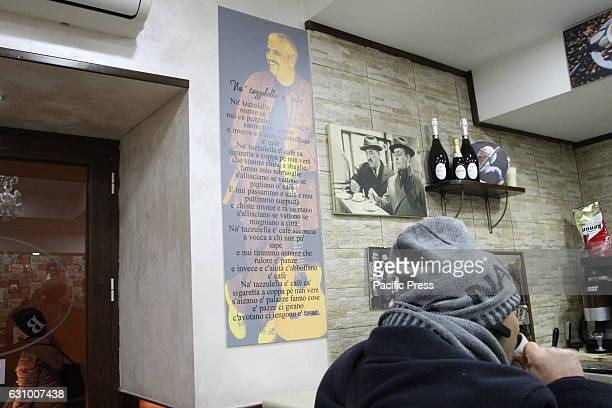 A commemorative sign with the verses of the song 'Na Tazzulella 'E Cafe' Two years after the death of Pino Daniele fans gathered in Piazza Santa...