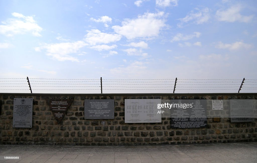 Commemorative signs are seen on the inside wall of the World War II concentration camp of Mauthausen, on April 17, 2013.