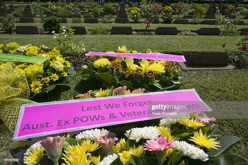 Commemorative wreaths lay on the ground during the Wreath Laying Ceremony at the War Cemetery in remembrance of all those who lost their lives, on April 25, 2013 in Kanchanaburi, Thailand. Hellfire Pass is a small section of the Burma-Thailand railway which was built by POW's and Asian Laborers under horrific conditions during the Second World War (WWII). Heavy loss of life was suffered during construction due to disease, starvation and exhaustion.