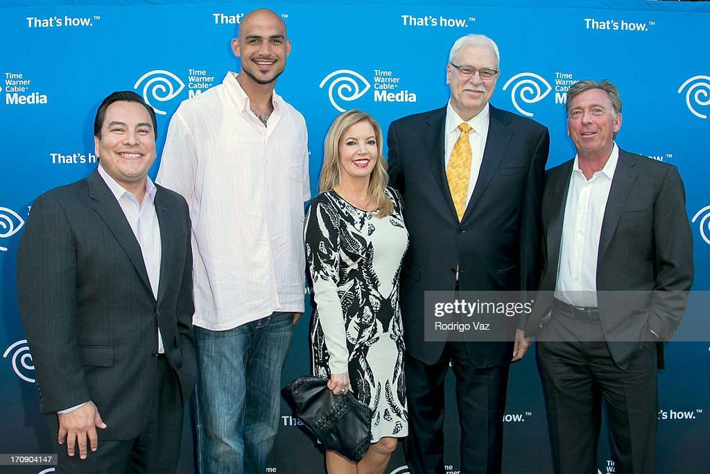Commentator Adrian Garcia Marquez, LA Lakers player <a gi-track='captionPersonalityLinkClicked' href=/galleries/search?phrase=Robert+Sacre&family=editorial&specificpeople=4682421 ng-click='$event.stopPropagation()'>Robert Sacre</a>, EVP Jeanie Buss, retired coach <a gi-track='captionPersonalityLinkClicked' href=/galleries/search?phrase=Phil+Jackson&family=editorial&specificpeople=201756 ng-click='$event.stopPropagation()'>Phil Jackson</a> and commentator Bill MacDonald attend the Time Warner Cable Media (TWC Media) 'View From The Top' Upfront at Vibiana on June 19, 2013 in Los Angeles, California.