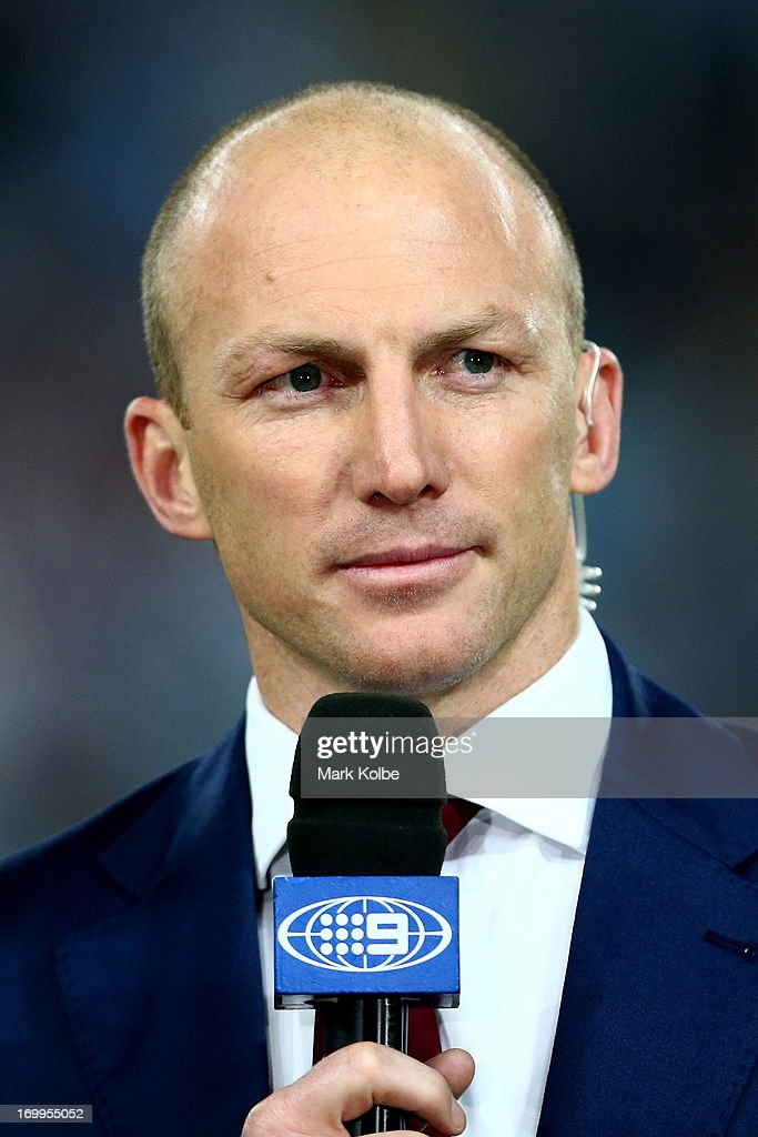 Commentator and former NRL player Darren Lockyer looks on during game one of the ARL State of Origin series between the New South Wales Blues and the Queensland Maroons at ANZ Stadium on June 5, 2013 in Sydney, Australia.